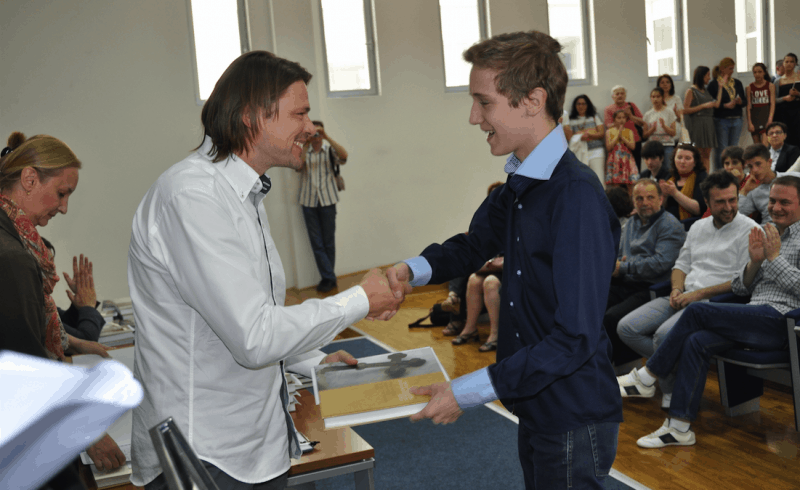 Predrag Lesic, CEO of .ME Registry, congratulating one of the students on great results.